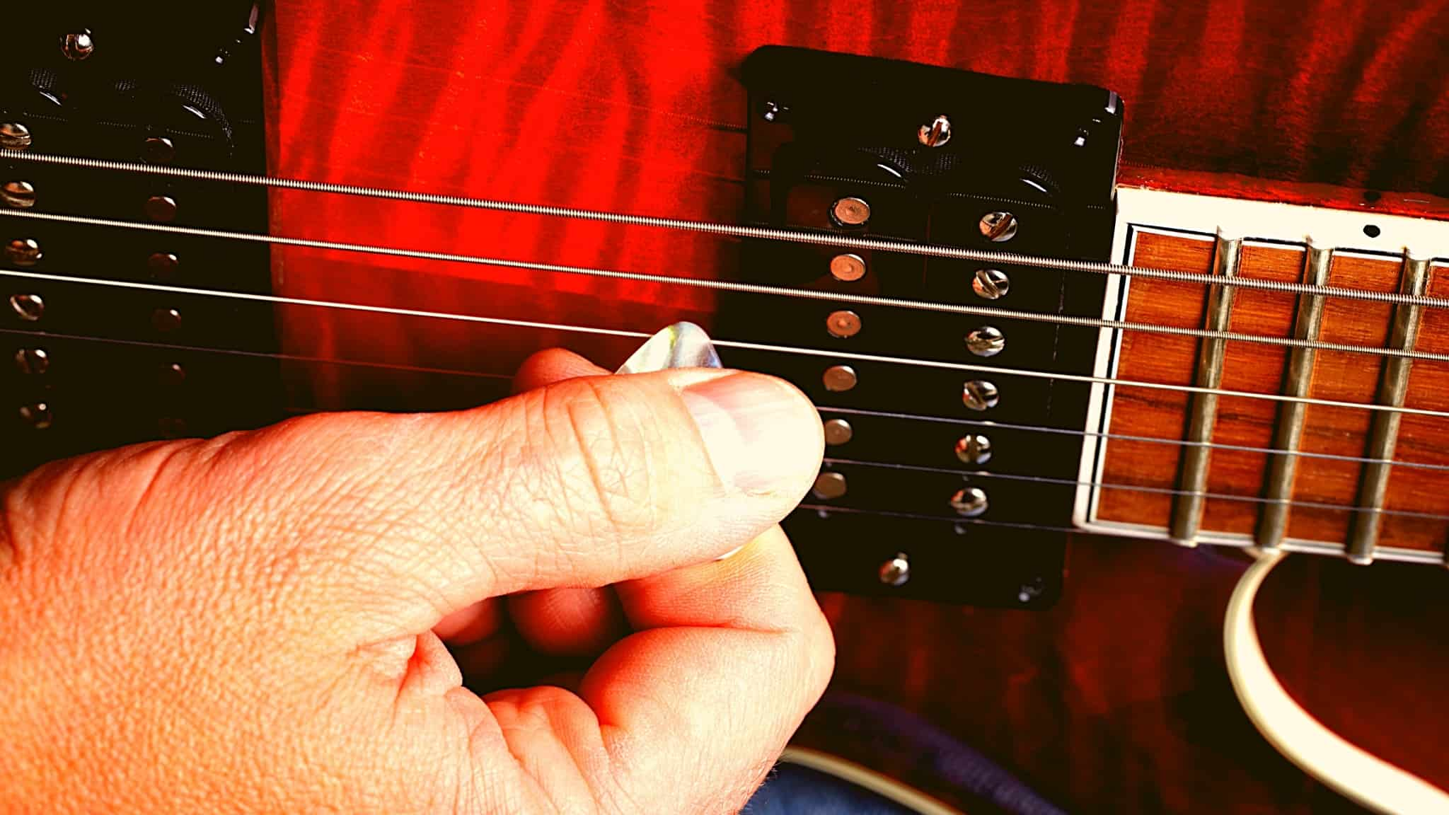 How to pick or strum a guitar